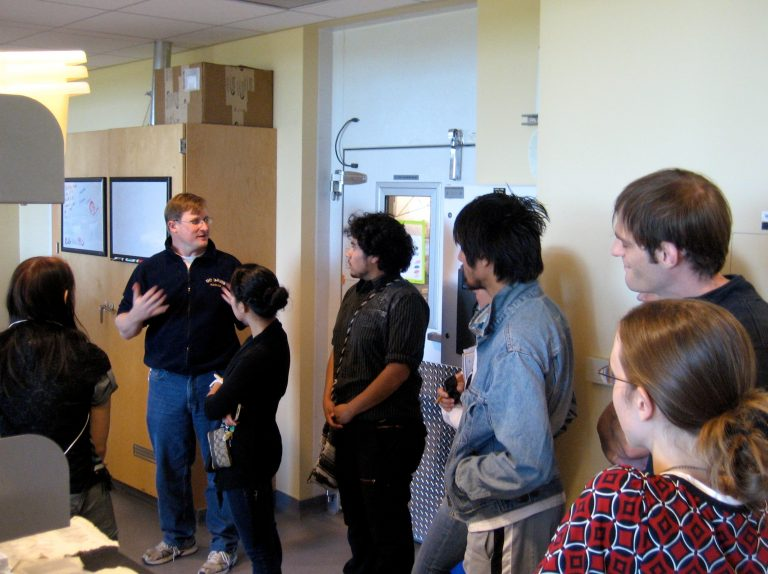 Professor Facciotti giving students a lab tour